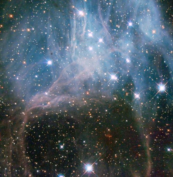 Хаббл заглядывает внутрь звездного облака...